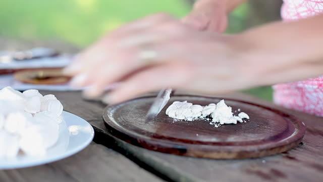 crushing meringue to nest fruit salad on top of - meringue stock videos & royalty-free footage