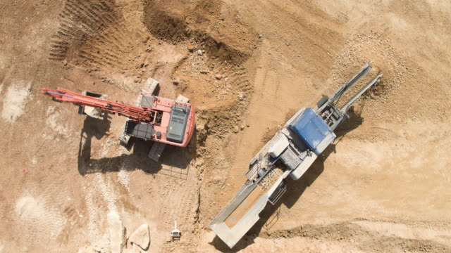 crushing rocks at quarry site - miniera video stock e b–roll