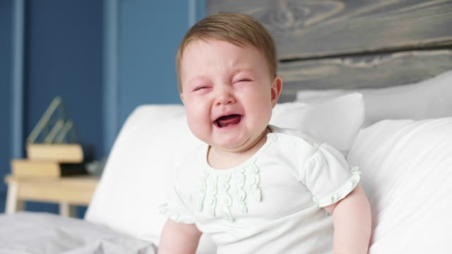 crying baby at bedroom/ debica/ poland - gridare video stock e b–roll