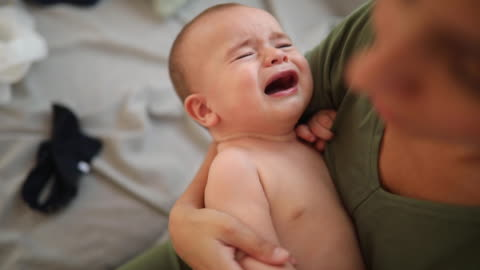 crying baby boy in mother's arms - shouting stock videos & royalty-free footage