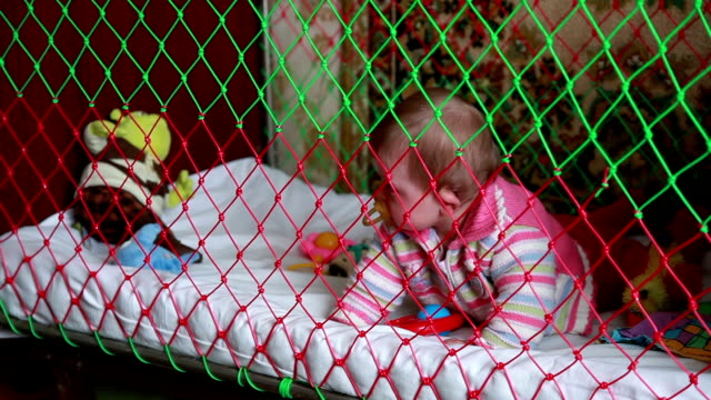 crying baby crawls in the crib - pacifier stock videos and b-roll footage