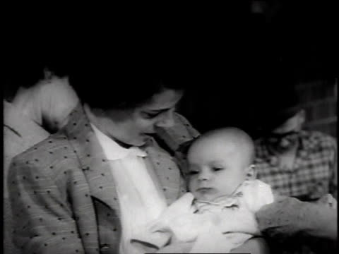 crying baby getting salk vaccine while others wait in line / kansas, usa - 1957 stock videos & royalty-free footage