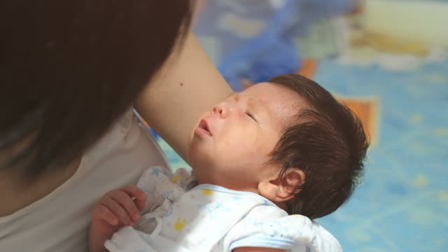 crying baby in mother embrace - postpartum depression stock videos & royalty-free footage