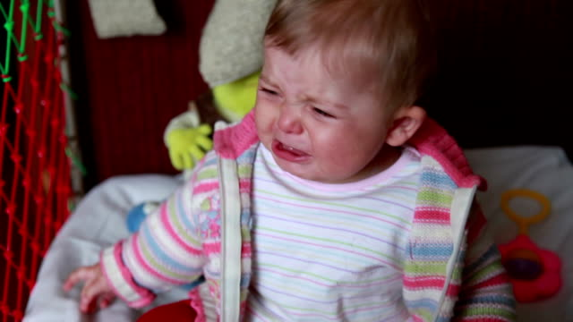 crying baby sitting in the crib - cot stock videos & royalty-free footage