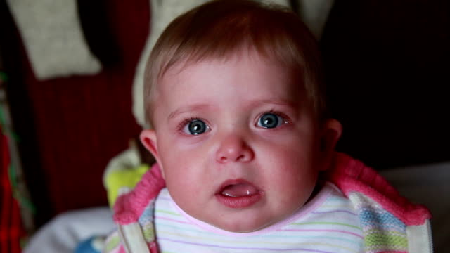 crying baby suddenly stop crying and stares at camera - baby human age stock videos and b-roll footage