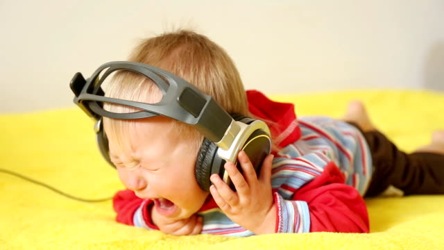 crying baby with headphones - one baby boy only stock videos & royalty-free footage