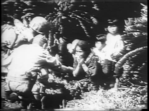 crying japanese mother holding her child / american marines offer cigarettes and comfort to a scared japanese family / the family bows to the... - pacific war stock videos & royalty-free footage