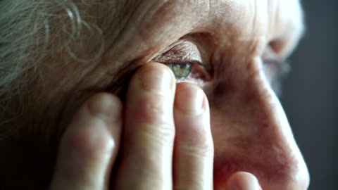 crying old woman dries her eyes with hand - eyesight stock videos & royalty-free footage