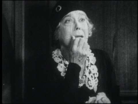 b/w 1932 crying senior woman with hand on face shaking with fear - fasa bildbanksvideor och videomaterial från bakom kulisserna