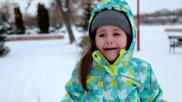 crying toddler outside on winter seasone - warm clothing stock videos & royalty-free footage