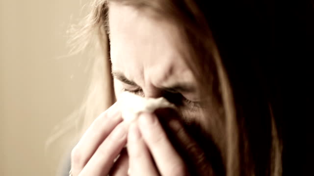 crying woman holding tissue - grief stock videos & royalty-free footage