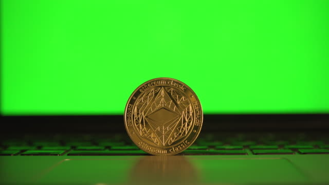 cryptocurrency ethereum in front a computer laptop green screen close up - blockchain stock videos & royalty-free footage