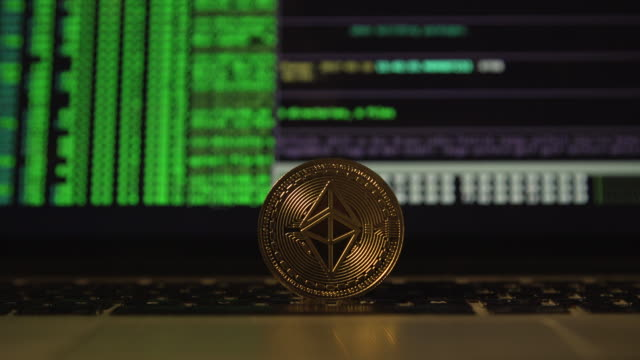 cryptocurrency ethereum in front a computer laptop screen close up - cryptocurrency stock videos & royalty-free footage