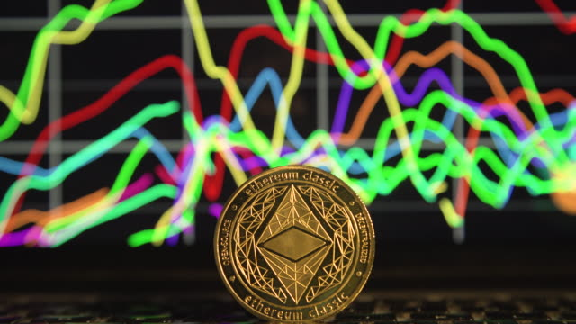 cryptocurrency ethereum in front economy chart from computer laptop screen close up - イーサリアム点の映像素材/bロール