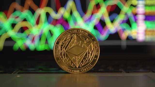 cryptocurrency ethereum in front economy chart from computer laptop screen close up - blockchain stock videos & royalty-free footage