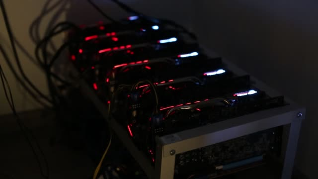 cryptocurrency mining machines sit in operating racks at the home of dmitry gutov, a russian cryptocurrency 'miner,' in krasnogorsk, russia, on... - イーサリアム点の映像素材/bロール