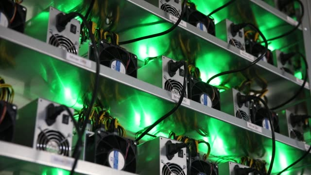 Cryptocurrency mining rigs composed of Antminer S9 ASIC machines operate on racks at the HydroMiner GmbH cryptocurrency mining facility near...