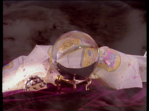 Crystal ball on stand with swirling mist