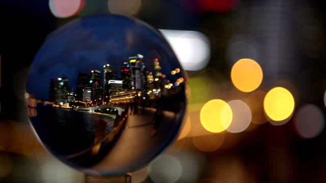crystal ball with reflection of singapore cbd skyline - crystal ball stock videos & royalty-free footage
