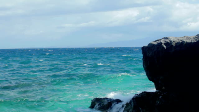 crystal blue beach waters with big rocks on foreground - batangas province stock videos and b-roll footage