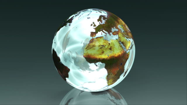 A crystal clear planet earth globe rotates (Loop).