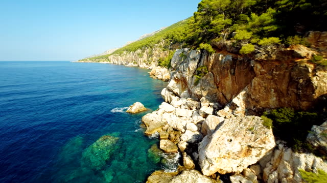 AERIAL Crystal Clear Sea Water On Island Hvar
