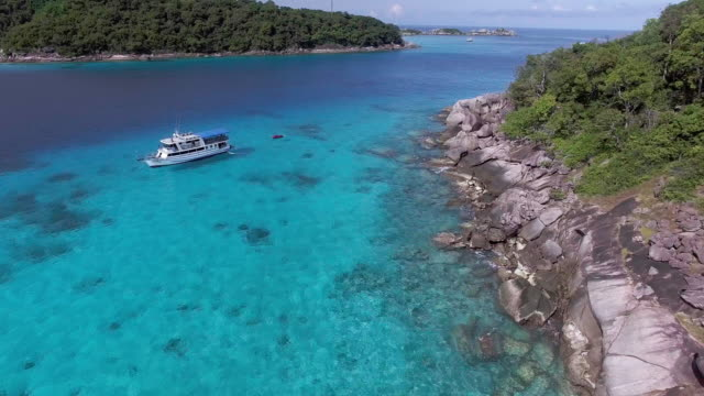 crystal clear water around the similan islands, thailand - david ewing stock videos & royalty-free footage