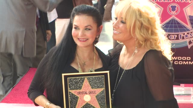 crystal gayle and tanya tucker at the crystal gayle is honored with a star on the hollywood walk of fame at hollywood ca. - tucker stock videos & royalty-free footage