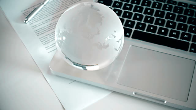 Crystal Globe On Laptop