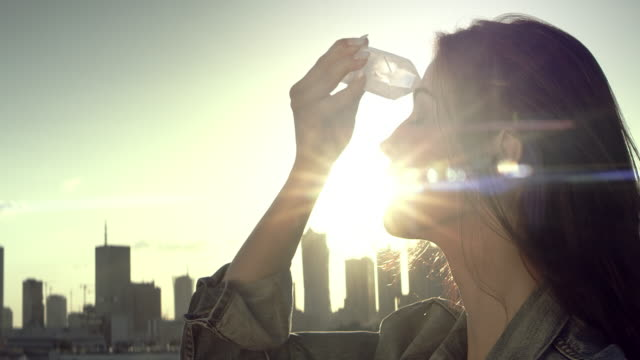 crystal healing. woman on a rooftop with city panorama - crystal stock videos & royalty-free footage