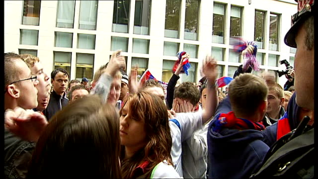 crystal palace fc saved from liquidation england london ext crystal palace fans singing and chanting outside lloyds banks headquarters as await news... - liquidation stock videos and b-roll footage
