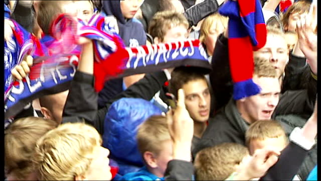 crystal palace fc saved from liquidation fan opening bottle of champagne and others chanting 'we'll stay up' and fans waving flags and scarves and... - neckwear stock videos and b-roll footage