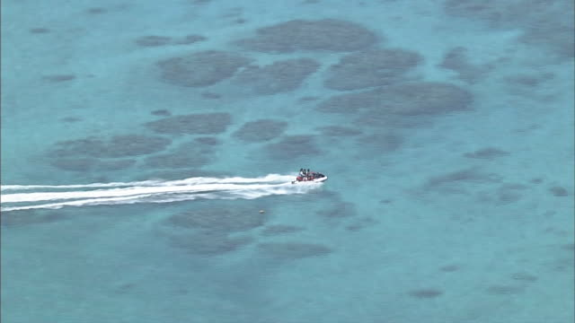 AERIAL Crystal-clear Water Sea around Tokashiki Island, Okinawa