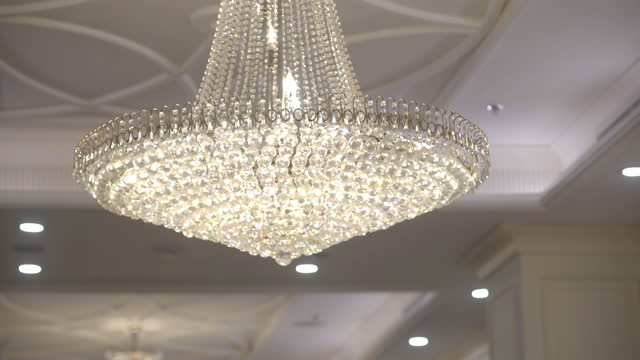 crystals chandelier at the luxury hotel - group of objects stock videos & royalty-free footage