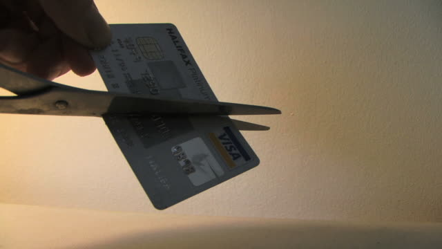 cu cutting credit card with scissor - cut video transition stock videos & royalty-free footage