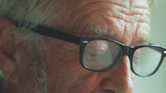 cu : mature man reading - reading glasses stock videos & royalty-free footage