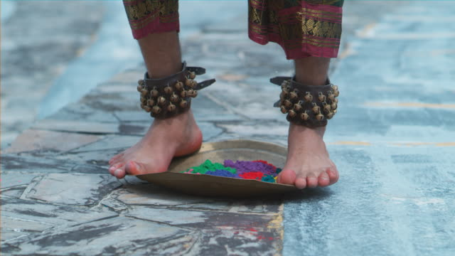 cu of indian dancer's feet jumping on metal tray filled with holi colors powder - powder paint stock videos & royalty-free footage
