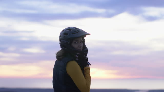 cu young woman taking off her cycling helmet - moving activity stock videos & royalty-free footage
