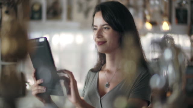 cu young woman working on a digital tablet - digital tablet stock videos & royalty-free footage