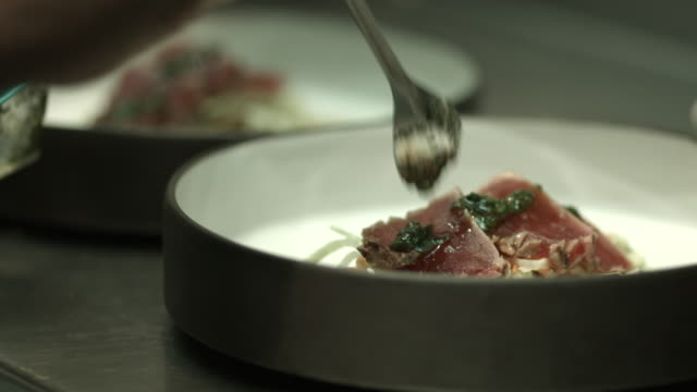 cu_chef finishing dishes with a topping of herb sauce - sauce stock videos and b-roll footage