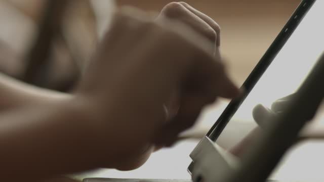 CU_Hands working on digital tablet
