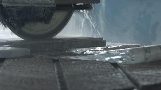 CU_Machine cutting threw marble slab, at factory