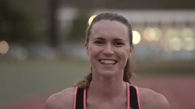 CU_Portrait of smiling female track athlete at stadium