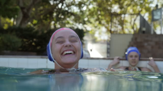 CU_Young female waterpolo player, laughing in the water