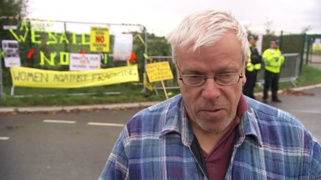 Cuadrilla to restart fracking in Lancashire ENGLAND Lancashire EXT Police officers moving protesters from road to allow lorry to pass outside...