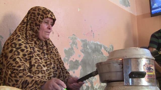 cuando la electricidad llega una vez al dia al hogar de los al zahar la familia entra en accion cargan los moviles cuecen pan en un horno electrico... - palestina stock videos and b-roll footage