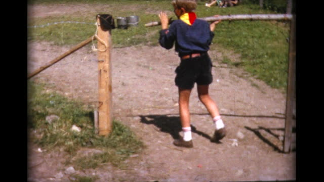 1964 cub scout struggles to close gate - cub scout stock videos and b-roll footage