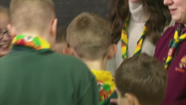 duchess of cambridge visits scout group more shots of kate chatting to children and taking part in scout activities / kate having her arm put in... - cub scout stock videos and b-roll footage