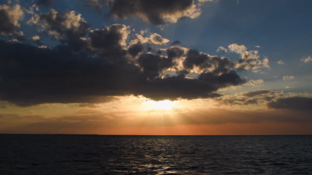 cuba hidden beauty: colorful sunset in the south sea of the sancti spiritus province. view from a fishing boat operated by locals. - sancti spiritus province stock videos and b-roll footage