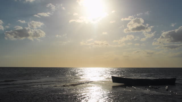 cuba hidden beauty: sunset in small fishermen town of tunas de zaza. boat by the shore of beach. the small human settlement is pretty much unknown and features an amazing beauty in nature - sancti spiritus province stock videos and b-roll footage